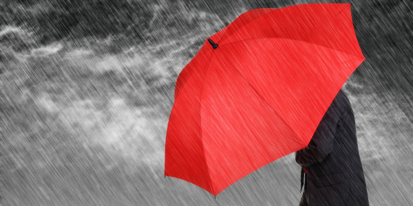 man with red umbrella caught in rain