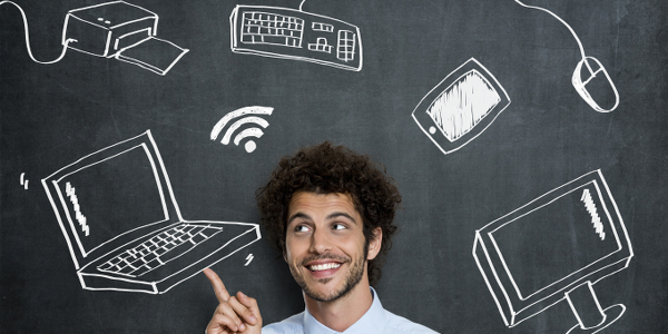 man pointing at technology on blackboard