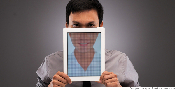 man with tablet in front of face